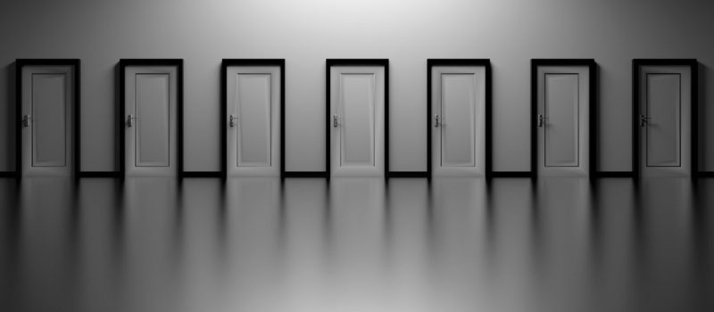 Black and white doors in a large corridor